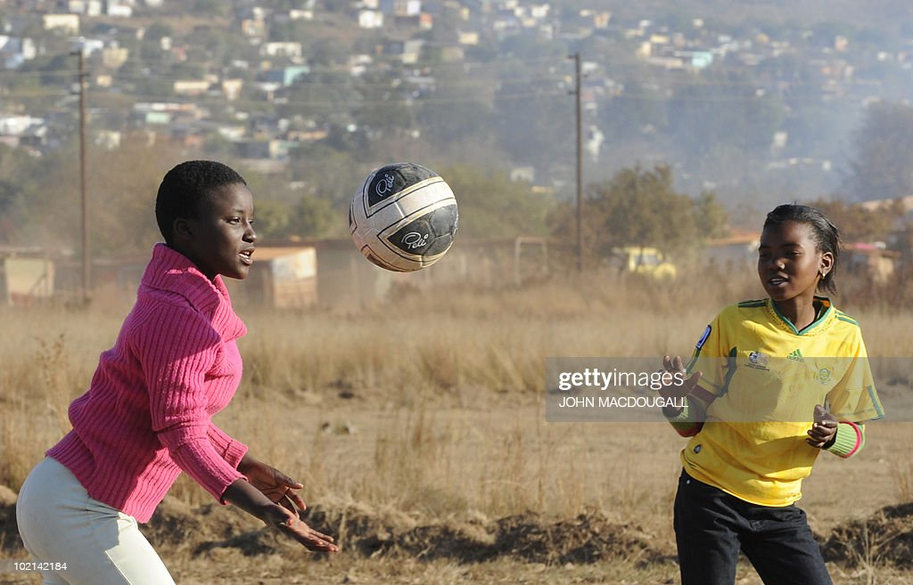 South African girls play with a ball at a makeshift football field outside the Atteridgeville township near Pretoria on June 16, 2010 as the 2010 World Cup is being held in South Africa.