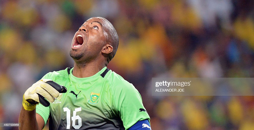 South African goalkeeper Itumeleng Khuneto gestures during a friendly football match South Africa vs Spain at the Soccer City Stadium in Soweto on November 19, 2013.