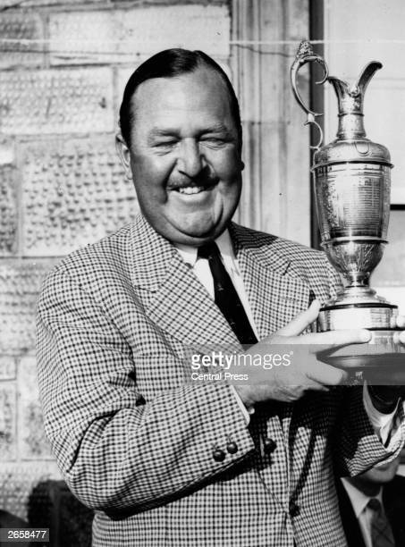 South African golfer Bobby Locke holding the Open Golf Championship Cup at St Andrews Scotland