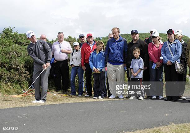 South African golfer Branden Grace chips onto the 6th green on the third day of the 138th British Open Championship at Turnberry Golf Course in south...