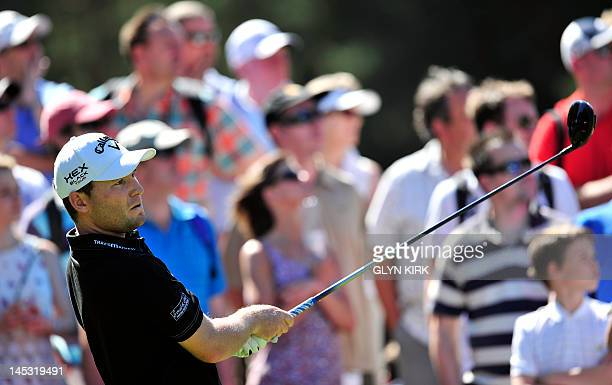 South African golfer Branden Grace watches his drive from the 11th tee during the third round of the PGA Championship at Wentworth Golf Club in...