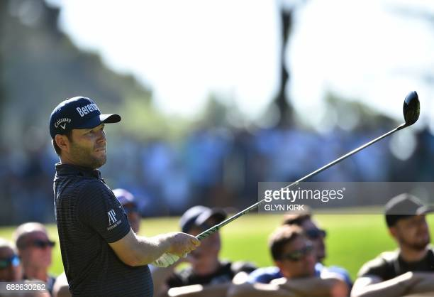 South African golfer Branden Grace watches his drive from the third tee on the second day of the golf PGA Championship at Wentworth Golf Club in...