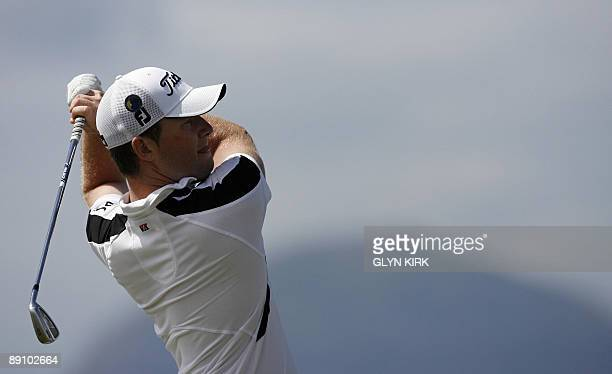 South African golfer Branden Grace watches his drive on the 4th tee on the final day of the 138th British Open Championship at Turnberry Golf Course...