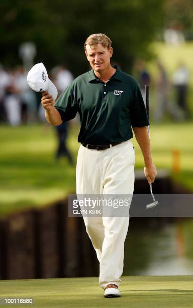 South African golfer Ernie Els acknowledges the crowd as he walks onto the 18th green during the second day of the European PGA Championship on the...