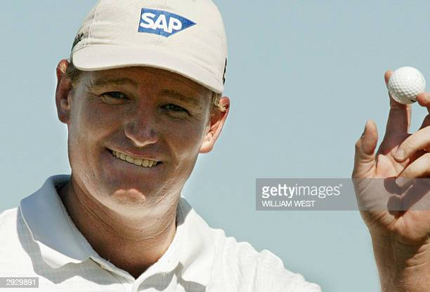 South African golfer Ernie Els celebrates sinking another birdie putt on the way to setting a course record 12 under par 60 during the first round of...
