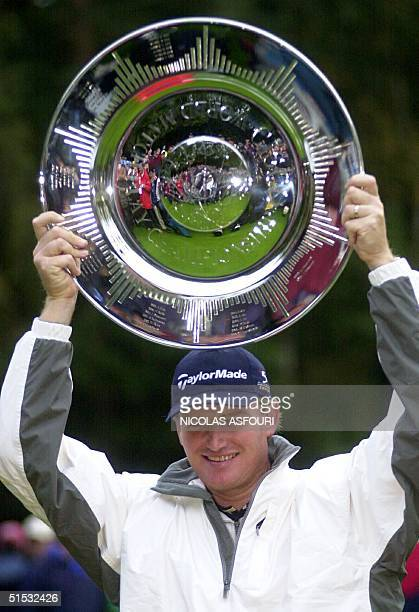 South African golfer Ernie Els holds up the Cisco World Match trophy after winning 3 up on the 17th green over Spaniard Sergio Garcia after he...