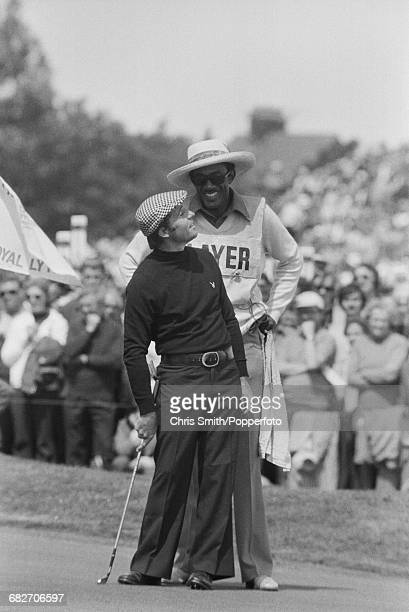 South African golfer Gary Player pictured with his caddy Alfred 'Rabbit' Dyer during action to win the 1974 Open Championship at Royal Lytham St...