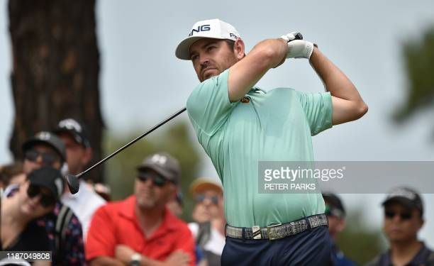 South African golfer Louis Oosthuizen hits a tee shot on day four of the Australian Open golf tournament at the Australian Golf Club in Sydney on...