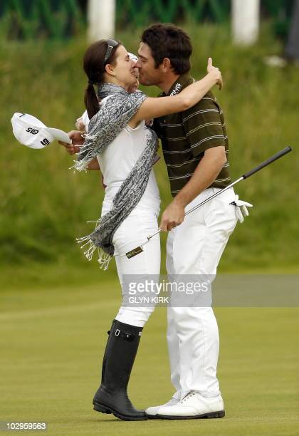 South African golfer Louis Oosthuizen is congratulated by his wife NelMare and daughter Jana on the 18th Green after winning the 139th British Open...
