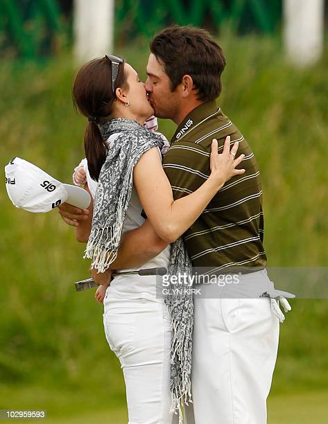 South African golfer Louis Oosthuizen kisses his wife NelMare on the 18th Green after winning the 139th British Open Golf Championship at St Andrews...