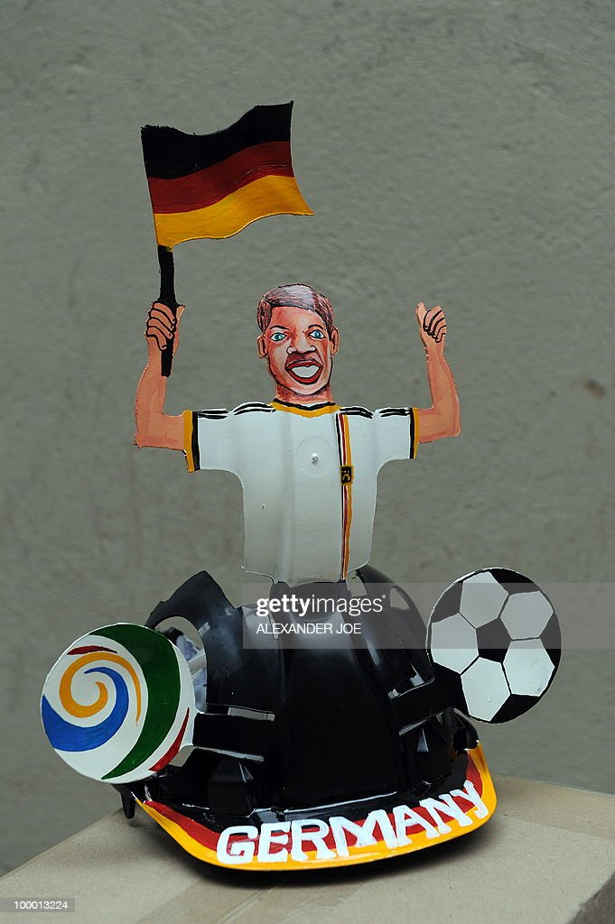 A South African hard hat known as 'Makarapas' made for the German national football team and its supporters is pictured in Johannesburg on March 24, 2010. The 'Makarapas', a decorated plastic hard hat to be settled on supporters' heads, are created by fans who carve shapes into the hats and adorn them with team colours, a process that can take four days to complete. As the world prepares for Africa's first World Cup, interest is growing in the continent, especially since the governing body FIFA ordered 2,000 Makarapas for twelve of the top teams from Wygers' factory in downtown Johannesburg. The Makarapa is, with the vuvuzela trumpet, an important part of the local football matches' festival atmosphere. Makarapas are hand-cut and hand painted miner hard hats in the colours of a team.