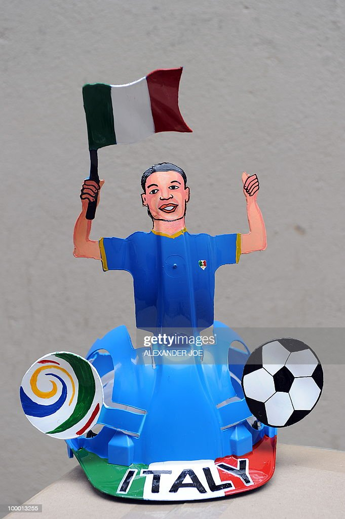 A South African hard hat known as 'Makarapas' made for the Italian football team and its supporters is pictured in Johannesburg on March 24, 2010. The 'Makarapas', a decorated plastic hard hat to be settled on supporters' heads, are created by fans who carve shapes into the hats and adorn them with team colours, a process that can take four days to complete. As the world prepares for Africa's first World Cup, interest is growing in the continent, especially since the governing body FIFA ordered 2,000 Makarapas for twelve of the top teams from Wygers' factory in downtown Johannesburg. The Makarapa is, with the vuvuzela trumpet, an important part of the local football matches' festival atmosphere. Makarapas are hand-cut and hand painted miner hard hats in the colours of a team.