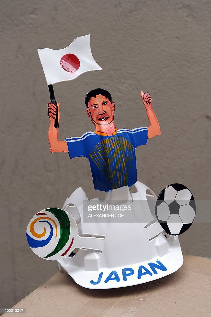 A South African hard hat known as 'Makarapas' made for the Japanese football team and its supporters is pictured in Johannesburg on March 24, 2010. The 'Makarapas', a decorated plastic hard hat, are created by carving shapes into construction hats and painting them in team colours, a process that can take four days to complete. As the world prepares for Africa's first World Cup, interest in the hats is growing in the continent. South African architect Paul Wygers, who designed the machine to create the cut outs in the hard hats, has received an order from football governing body FIFA for 2,000 Makarapas for the twelve of the top teams.