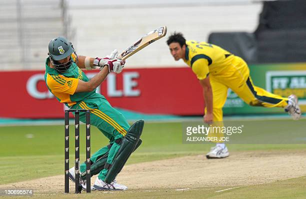 South African Hashim Amla avoids a bouncer from Australian Mitchell Johnson during the 3rd One Day International at Kingsmead Stadium in Durban on...