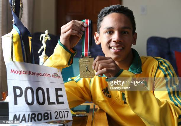 South African high jumper Breyton Poole 17 shows his gold medal during an interview at his home on July 20 2017 in Cape Town South Africa The Grade...