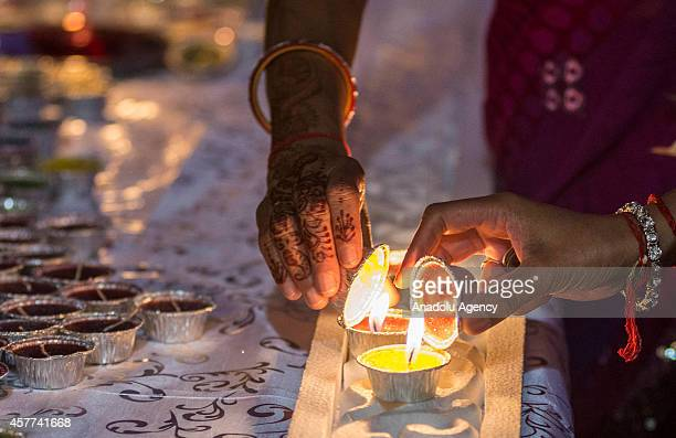 South African Hindus perform a prayer as they celebrate the holy holiday of Diwali at a temple in Johannesburg South Africa on October 23 2014 Diwali...