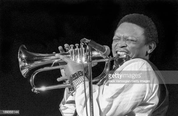 South African jazz musician Hugh Masekela plays fluegelhorn during a performance at the Manhattan Center New York New York March 11 1994