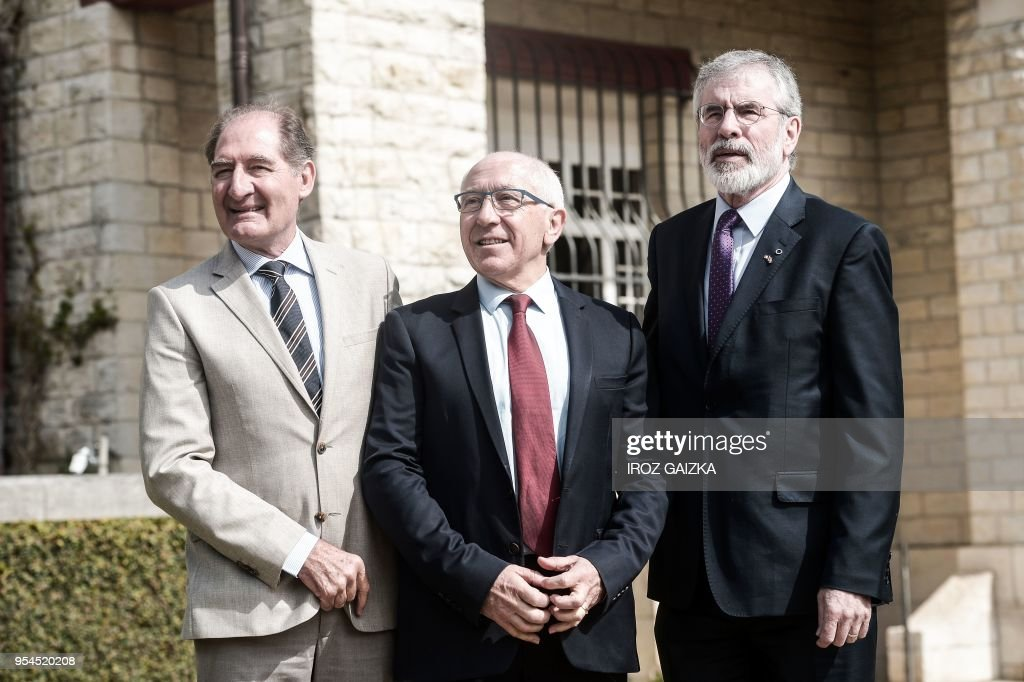 South African lawyer Brian Currin, Bayonne's mayor Jean-Rene Etchegaray and Northern Ireland's Gerry Adams pose as they arrive to attend a peace conference to end ETA's days-long dissolution process on May 4, 2018 in the small southwestern French town of Cambo-les-Bains, French Basque Country.