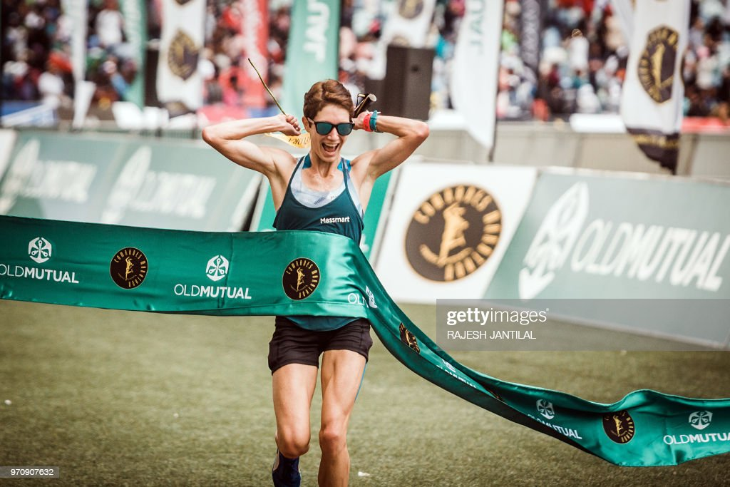 South African long-distance runner Ann Ashworth reacts after passing the finish line and winning the 89km Women's Comrades Marathon between Pietermaritzburg and Durban on June 10, 2018. - The annual marathon this year attracted over 20,000 runners from around the world.