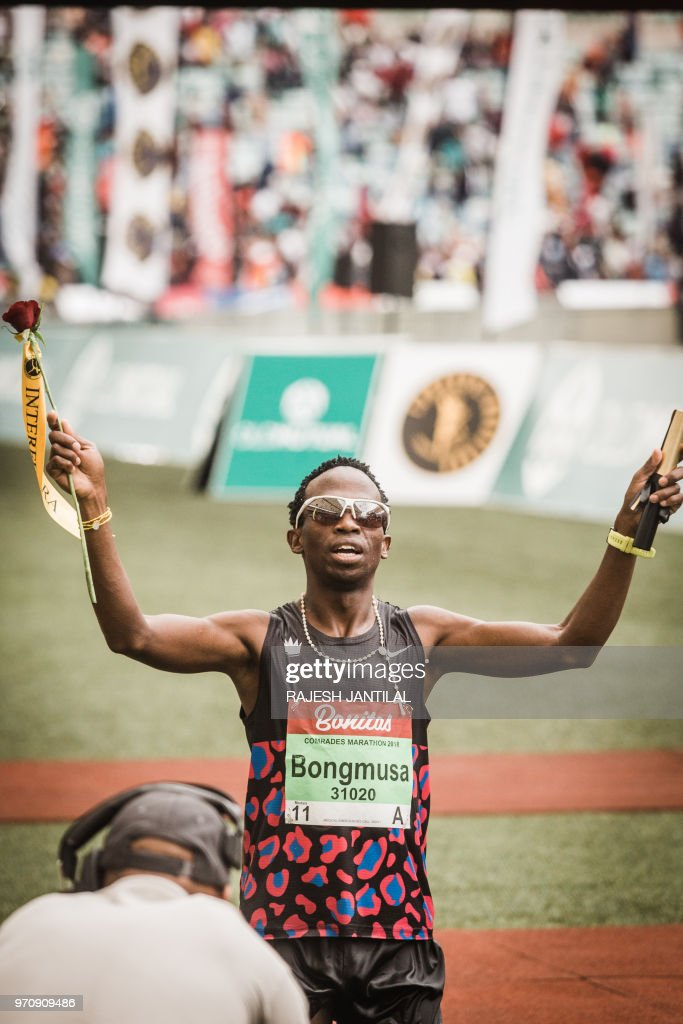 South African long-distance runner Bongmusa Mthembu reacts after passing the finish line and winning the 89km Mens Comrades Marathon between Pietermaritzburg and Durban on June 10, 2018.The annual ultra marathon this year attracted over 20,000 runners from around the world.