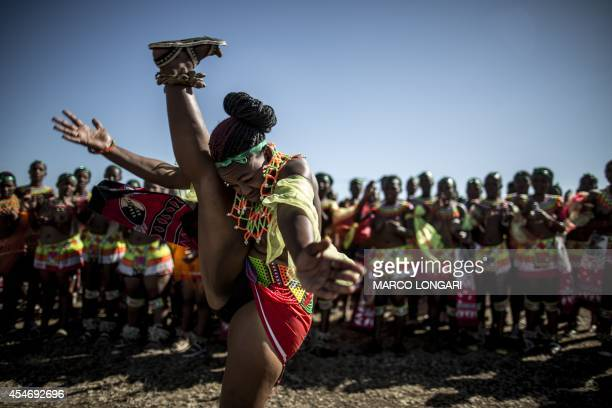 A South African maiden dances as others clap during the Reed Dance ceremony on September 5 2014 at the eNyokeni Royal Palace in Nongoma in the...