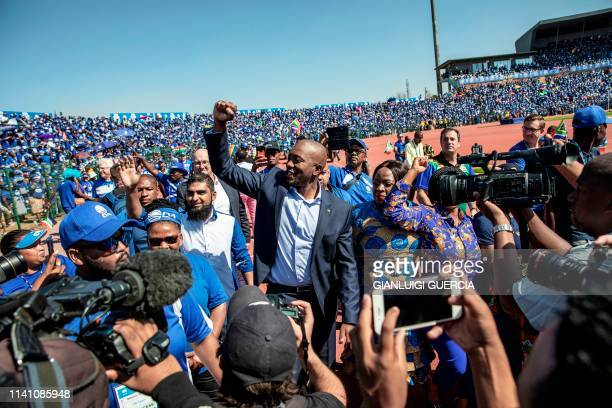 TOPSHOT South African main opposition party Democratic Alliance leader Mmusi Maimane gestures during the final presidential election campaign rally...