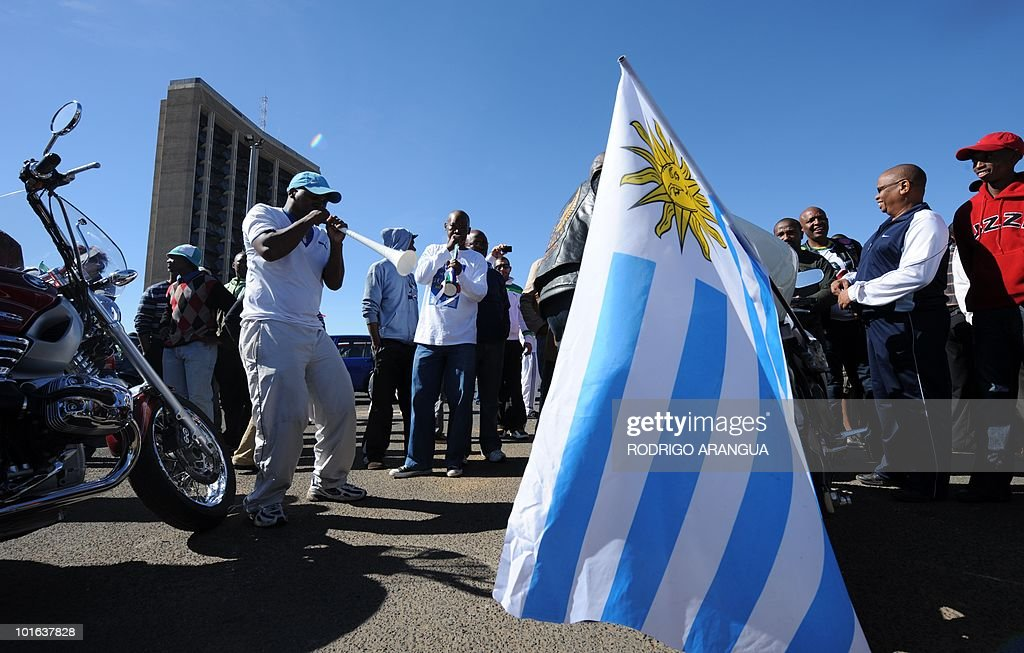 A South African man blows a vuvuzela during preparations to welcome the Uruguayan national football team in Kimberley, on June 5, 2010 ahead of the start of the South Africa 2010 World Cup on June 11. AFP PHOTO/ Rodrigo ARANGUA