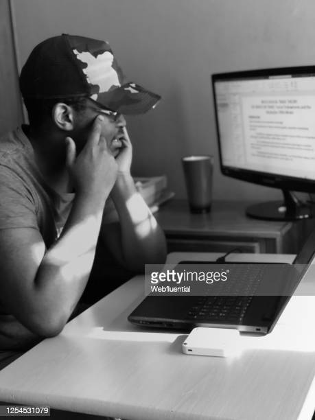south african man working from home during covid-19 pandemic - webfluential stock pictures, royalty-free photos & images