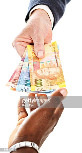south african mandela banknotes being passed to male hand - south african currency stock photos and pictures