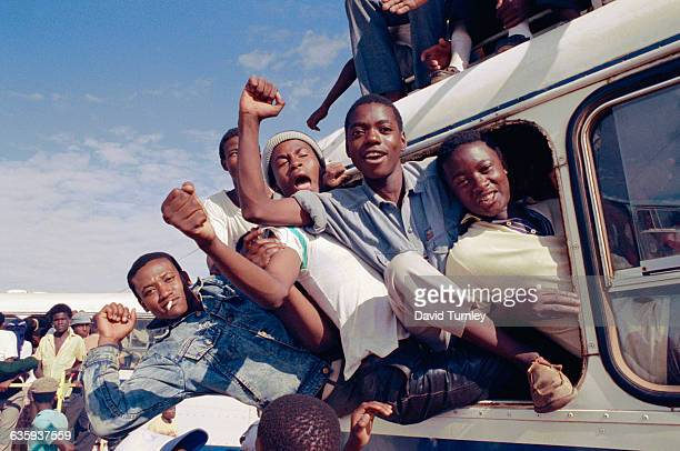 South African men cheer and celebrate the news of Nelson Mandela's release from prison.