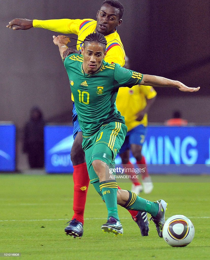 South African midfielder Steven Pienaar avoids a tackel fom Colombia's Jackson martinez during a friendly football match between South Africa vs Colombia at Soccer City Stadium in Soweto on May 27 , 2010 ahaed of the FIFA 2010 World Cup in South Africa.