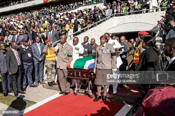 TOPSHOT South African military personnel bring in the coffin of Winnie MadikizelaMandela at Orlando Stadium for the funeral ceremony in Soweto South...