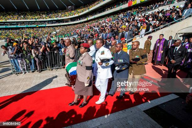 South African military personnel bring in the coffin of Winnie MadikizelaMandela at Orlando Stadium for the funeral ceremony in Soweto South Africa...