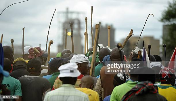 South African miners hold up sticks during a strike in Marikana on January 30 2014 South Africa's platinum mineworkers rejected a fresh wage offer at...