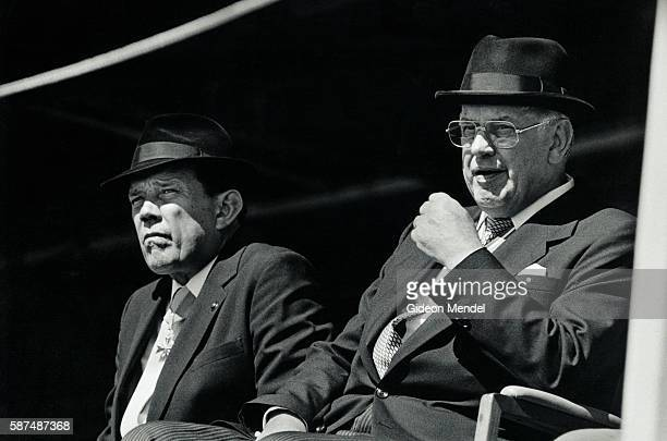 South African Minister of Defense Magnus Malan sits alongside South African President Pieter Willem Botha during a military parade in Cape Town...