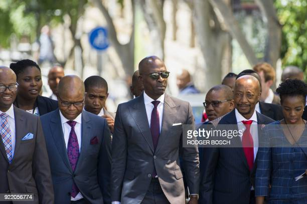 South African Minister of Finance Malusi Gigaba walks with members of the Finance Ministry S'fiso Buthelezi and South African Revenue Service head...