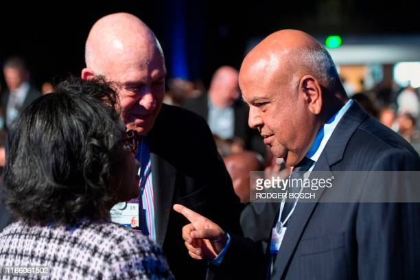 South African Minister of Public Enterprises talks to South African businessman Geoffrey Rothschild , during the World Economic Forum Africa meeting...