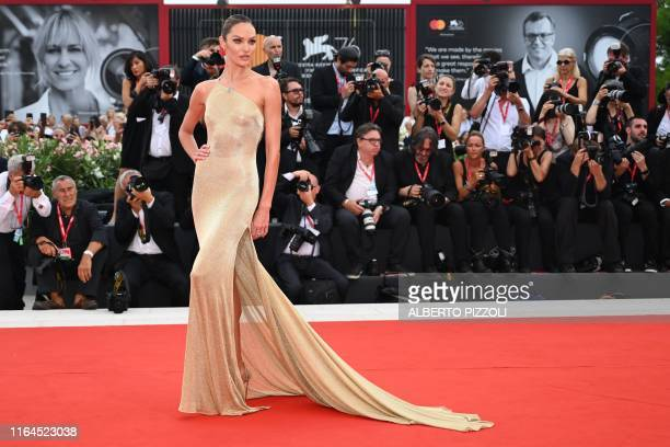 South African model Candice Swanepoel poses as she arrives for the opening ceremony and the screening of the film La Verite presented in competition...