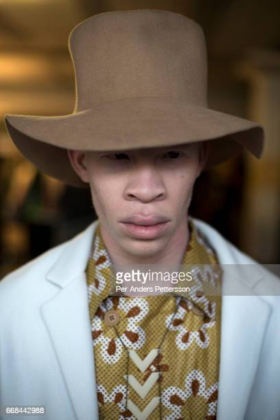 South African model Sanele Junior Xaba stands backstage before a show with the South African designer Chu Suwanapha during the South African Menswear...