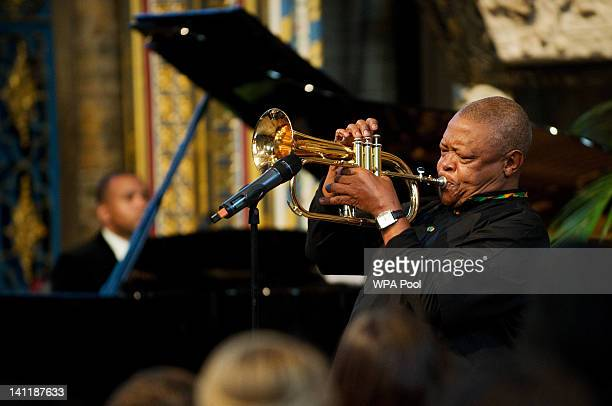 South African musician Hugh Masekela performs during the annual Commonwealth Day Observance Service at Westminster Abbey on March 12 2012 in London...