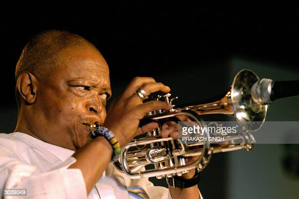 South African Musician Hugh Masekela plays a trumpet as he performs during a cultural event to celebrate 'South Africa's 10 years of Freedom' in New...
