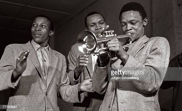 South African musician Hugh Masekela plays the trumpet he has just received as a gift from Louis Armstrong via local chaplain Father Trevor...