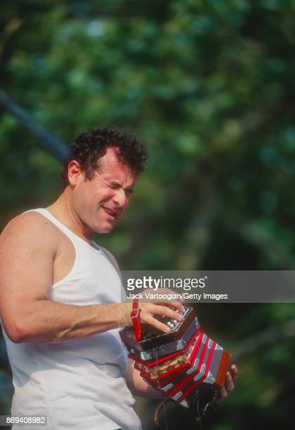 South African musician Johnny Clegg plays concertina as he performs with his band Juluka at Central Park SummerStage New York New York July 14 1996