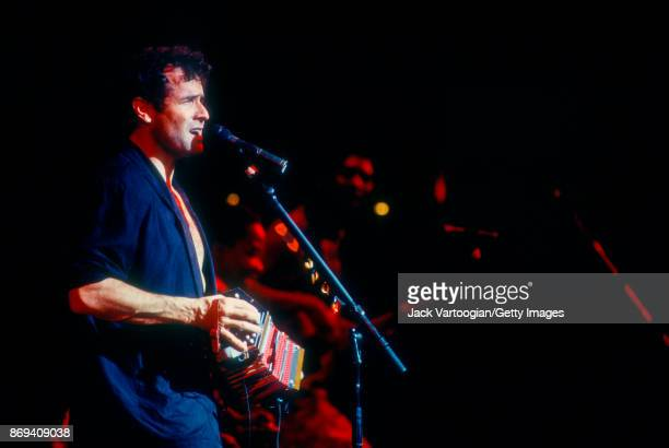 South African musician Johnny Clegg plays concertina as he performs with his band Savuka at Town Hall New York New York July 14 1996