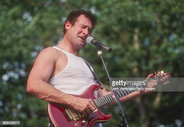 South African musician Johnny Clegg plays guitar as he performs with his band Juluka at Central Park SummerStage New York New York July 14 1996
