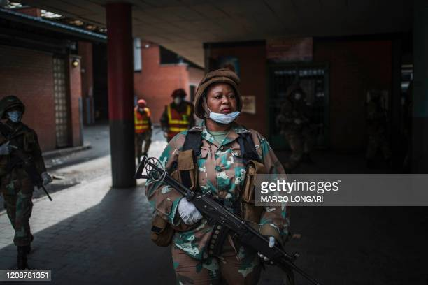 A South African National Defence Force patrol walks through the Johannesburg CBD on April 1 2020 during a lockdown enforcing operation South Africa...