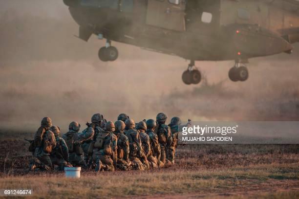 South African National Defence Force personnel take part in a military training exercise at Roodewal Airforce base in the Limpopo Province South...