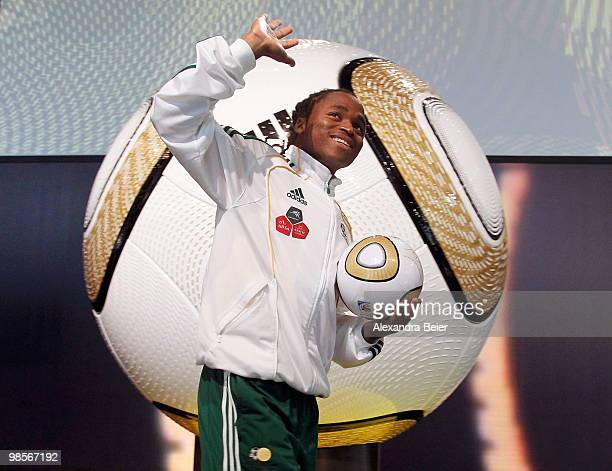 South African national football player Sphiwe Shabalala waves as he arrives for the presentation of the FIFA World Cup 2010 final match ball on April...