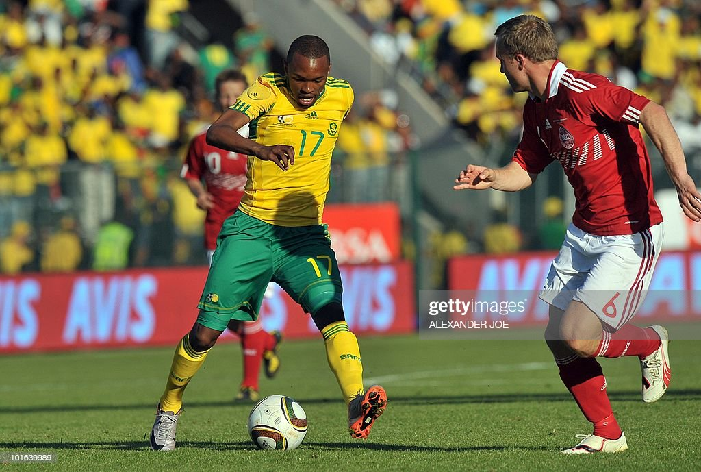 South African national football team striker Bernard Parker (L) fights for the ball with Denmark's defender Lars Jacobsen during their friendly match at Super Stadium in Pretoria on June 5, 2010 ahead of the FIFA 2010 World Cup in South Africa.