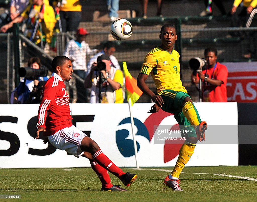 South African national football team striker Katlego Mphela (R) fights for the ball with Denmark's Thomas Kahlenberg during their friendly match at Super Stadium in Pretoria on June 5, 2010 ahead of the FIFA 2010 World Cup in South Africa.
